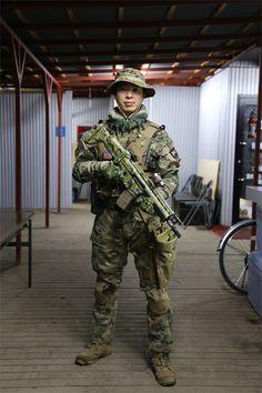 Airsoft Player in Japan. Fashion Photo. Multicam camo BDU. Military. Gun. Combat