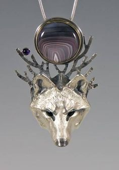 Handcrafted Silver Jewelry by Brooke Stone: White Wolf under New Moon - Cast silver, fabricated silver, Botswana agate, amethyst, onyx eyes