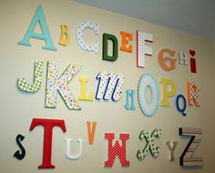 I this is a great idea but with scrapbook paper from the dollar store or michael's great fro singing the Alphabet and doing sounds. easy cheap educational room decor