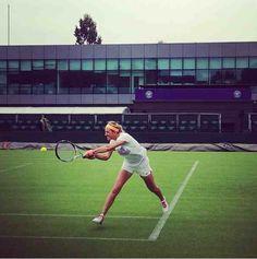 Asarenka hits a powerful shot while practising. @Wimbledon @Kathy O'Neill