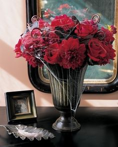 For a fancier Halloween party or house decor this spider web wrapped flower arrangement feels Gothic and festive for Halloween.