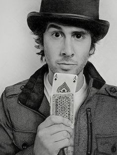Josh Groban being himself. The expression on his face with the cards and top hat just adds more silliness. Quite typical of the Grobes. (~=
