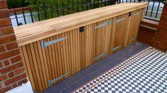 Bin Store clad in cedar with slatted roof over felt