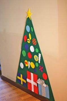 The idea for felt Christmas trees has been all over Pinterest recently, but my absolute favorite has been this version from Johnny in a Dress.  I love the