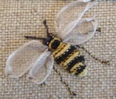 I love this bee! the best one I have ever seen in ribbon work | Call A1 Bee Specialists in Bloomfield Hills, MI today at (248) 467-4849 to schedule an appointment if you've got a stinging insect problem around your house or place of business! You can also visit www.a1beespecialists.com!