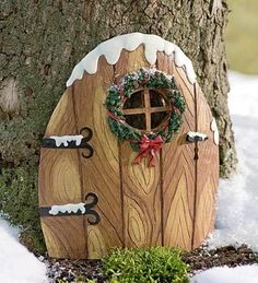 Fairy door decorated for Christmas.