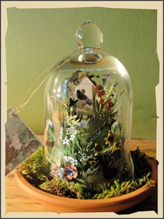 Handcut gardens under glass using the art of Scherenschnitte from Jeri Landers