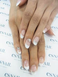 Rounded French tips with rhinestones