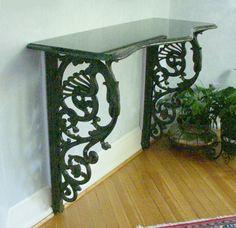 cast iron brackets + antique shelf = unique console table