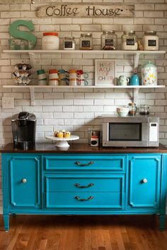 I would LOVE to have this in any home, no matter how small. Have a small counter or rolling cart with the coffee pot and espresso machine, shelves on the wall for cups, flavoring and sugar  cute signs, colorful