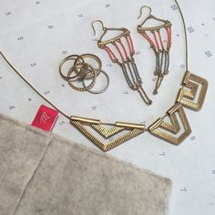 Madewell Necklace, Earrings, and Stack Ring Bundle Madewell bronze/gold geometric necklace, chain drop earrings, and 4 stackable rings (size 6 or 7). Madewell Jewelry