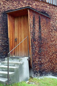 Saint Benedict Chapel - Peter Zumthor outside of small gallery? Peter Zumthor, Detail Architecture, Interior Architecture, Entry Doors, Entrance, Interior Exterior, Interior Design, Beton Design, Timber Cladding