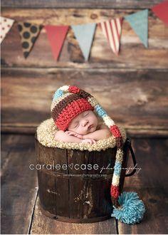 Love the rust,brown,blue hat! Newborn shoot.