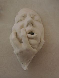 Ceramic face and hand. Fuori Salone Milano 2013
