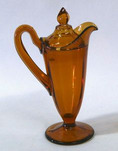 Amber Syrup Pitcher with lid. on May 2008 Amber Bottles, Amber Glass, Art Deco Glass, Amber Color, Glass Dishes, Vintage Glassware, Colored Glass, Light In The Dark, Pottery
