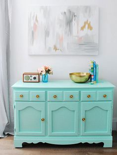 Gemma of The Sweetest Digs had been looking for a dining room buffet when she spied this $5 wooden dresser at a garage sale. The storage piece was in good shape, only requiring a light sanding before transforming it into this bright buffet. A quick spritz of spray paint updated the brassy knobs into shiny gold circles./