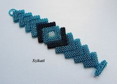 FREE SHIPPING!!!  Elegant one-of-a-kind seed bead cuff bracelet with an absolute unique, eye ketching shape and design.  Theres no metal piece in it, so I calmly recommend it to anyone with metal allergy too.  Length: appr. 7,4 inches / 18,5 cm Width: 1,8 - 1,2 inches / 4,5 - 3 cm Closure: handmade clasp beaded of seed beads  Technique: Cubic Right Angle Weave (CRAW)  The bracelet is my own original design!  This handcrafted piece of fashion jewelry will be a great addition to your unique…