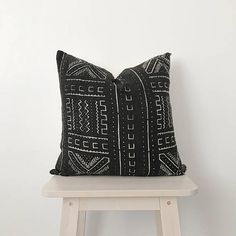 Authentic African Mudcloth decorative pillow. The back is made of natural canvas. Gold zipper enclosure. About 19x19 square.  Fabric and pillow made by hand, so each will have a slight variation. Pillow fill not included. Dry clean only.
