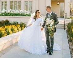 modest wedding dress with elbow sleeves and a flowing skirt from alta moda. -- (modest bridal gown) --
