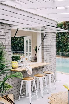 Pool house! Outdoor bar stools // pool bars for the home // chic outdoor spaces