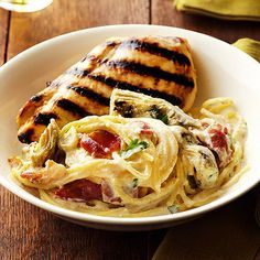 This dish combines artichoke and bacon carbonara with flavorful grilled chicken. More of our best grilled chicken recipes: http://www.bhg.com/recipes/chicken/grilled/grilled-chicken-recipes/?socsrc=bhgpin072113chickenandcarbonara=6