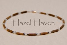 SALE 20% OFF - Therapeutic Hazelwood Necklace, Size 17-18 Inch, Hematite and White Cats Eye Beads. $20.00, via Etsy.