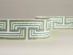 Maze Border A stunning border braid with a maze design inspired by traditional carpet borders and shown in turquoise and sage green on a white ground. Perfect for edging curtains, furniture or accessories.