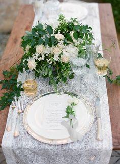 lace table runner - photo by Stefanie Kapra Photography http://ruffledblog.com/elegant-wedding-inspiration-in-tuscany #weddingideas #tablescape #tablerunner