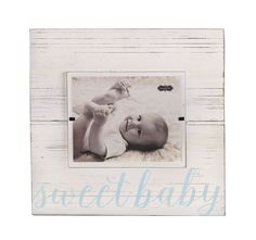 Oversized white distressed frame with raised wood mat features blue printed…