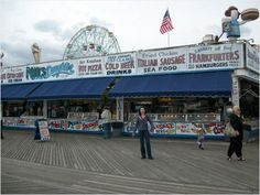 Strolling up and down the boardwalk at Coney Island. Fun day. Live music, beer, pizza and Nathans hot dogs.