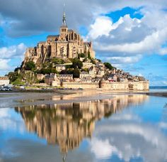 Here's a great shot of Mont Saint-Michel in Normandy, France. Is France on your wish list? Mont Saint Michel France, Le Mont St Michel, Best Vacation Destinations, Best Vacations, France Destinations, Vacation Travel, Beautiful Castles, Beautiful Places, Segway Tour