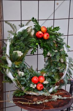 Christmas wreath Love the apples, not so sure about the roving?