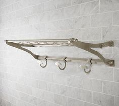 I got this for $99.96 including a hefty shipping fee but originally it was based on a thing to hang your coats turned into a towel rack. I am turning a towel rack into a coat rack! Small condos... got to do what you got to do! It was the cheapest and yet prettiest choice for the hallway! Cannot wait to paint the hallway and have this up soon!