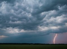 A storm passes over a field near Hasenfelde in the eastern German state of Brandenburg.