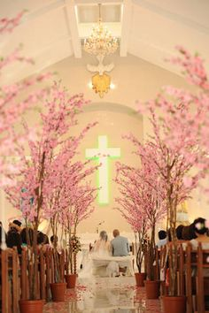 Ceremony Decor-Dreamy cherry blossom trees lined the church's aisle...maybe for the reception so it doesn't block anyone's view? Then can plant at home!