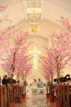 Ceremony Decor-Dreamy cherry blossom trees lined the church's aisle...