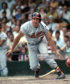 Third baseman Brooks Robinson #5 of the Baltimore Orioles, watches the ball he's…