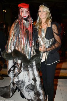 Bold: The blonde caught up with Daniel Lismore (L) at the event - who put on a typically striking display in a cape ensemble of black flowers and glitter