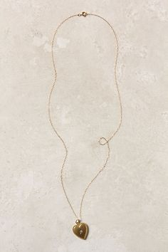 Classic locket.. Always in style!  The yellow gold will warm you! Diamond & Gold Heart Necklace #anthropologie