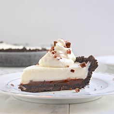 Frozen Grasshopper Pie with a layer of Mint Fudge and Oreo Cookie Crust.