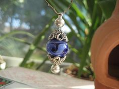 Glass lampwork bead pendant    http://www.etsy.com/shop/ChrissieBeads