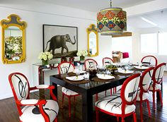 African inspired dining room with earthy pendant light interior design