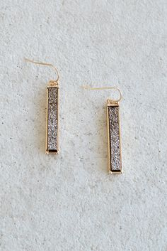 "Bling, bling! These druzy bar earrings in a fabulous chocolate brown color with automatically spice up any outfit. Long, rectangular shape with J-shaped hook. Gold framework. -1.25"" in length -Lead co"