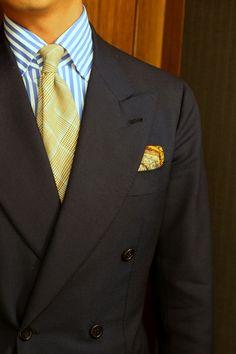 Dark double-breasted suit, striped shirt, gold glen plaid tie, gold paisley pocket square. Good. (Items by: Orazio Luciano, Liverano & Liverano, Drakes)