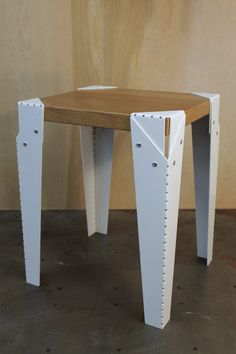 The Dotted Lines Stool is the perfect addition to any space. It can be used as a stool or side table. The legs are made of laser cut steel with a