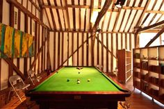 Super studwork in this converted barn and a pool table!