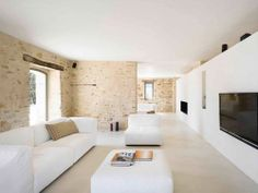 House renovation in Treia - Wespi de Meuron Romeo architects; modern, rustic white, just needs more bookcases