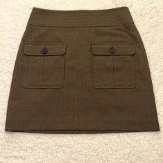 Olive green Loft skirt In great condition! 17.5in long, 15in at the waist and 19.5 across the bottom. LOFT Skirts