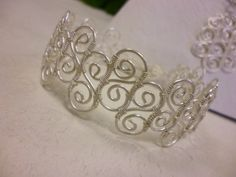 Wire spirals wrapped together to make a bracelet.