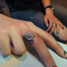 I LOVE this micro rose finger tattoo by Bang Bang Tattoos soooo much!!!